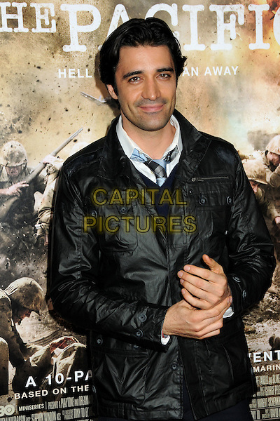 "GILLES MARINI.HBO's ""The Pacific"" Mini-Series Premiere held at Grauman's Chinese Theatre, Hollywood, California, USA..February 24th, 2010.half length black jacket hands .CAP/ADM/BP.©Byron Purvis/AdMedia/Capital Pictures."