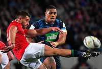 Rhys Webb clears under pressure from Ofa Tu'ungafasi during the 2017 DHL Lions Series rugby union match between the Blues and British & Irish Lions at Eden Park in Auckland, New Zealand on Wednesday, 7 June 2017. Photo: Dave Lintott / lintottphoto.co.nz