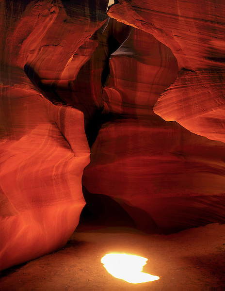 Sunburst in Antelope Canyon (slot canyon) near Page, Arizona .  John offers private photo tours in Arizona and and Colorado. Year-round.