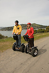 Couple on Segways at Angel Island State Park, San Francisco Bay, California.  Model released.  Photo camari213-70405.  .Photo copyright Lee Foster, www.fostertravel.com, 510-549-2202, lee@fostertravel.com.