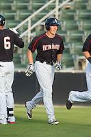 Carl Thomore (13) of the Kannapolis Intimidators is all smiles as he returns to the dugout after hitting a grand-slam against the Delmarva Shorebirds at CMC-NorthEast Stadium on July 2, 2014 in Kannapolis, North Carolina.  The Intimidators defeated the Shorebirds 6-4. (Brian Westerholt/Four Seam Images)