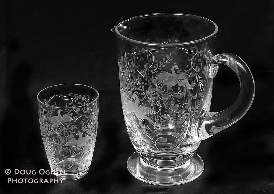 Etched crystal glass and pitcher on black screen.  Images used in Estate valuation and auction program.
