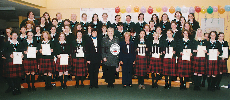 Pictured receiving the Gaisce Presidents awards at a special ceremony in the school are 47 students from Scoil Mhuire, Ennistymon, with teacher Seosaimhín Ní Dhomhnallain, Minister Síle de Valera and Siobhan Quinn, principal - April 16, 1999. Photograph by Eamon Ward