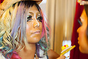 A female customer is transformed with ganguro make-up by Erimokkori, a member of staff, at the Ganguro Cafe &amp; Bar in the Shibuya shopping area on September 4, 2015. <br /> <br /> Ganguro is an alternative Japanese fashion trend which started in the mid-1990s where young women, rebelling against the traditional idea of Japanese beauty, wore colorful make-up and clothes and had dark-skin.<br /> <br /> 10 Ganguro fashion girls work in the new bar, which offers original Ganguro Balls (fried takoyaki style sausage balls in black squid ink batter) on its menu. Ganguro Caf&eacute; &amp; Bar also offers special services such as Ganguro make-up and the chance to take purikura (photo booth pictures) with staff and to look like a Ganguro girl walking around the Shibuya streets.<br /> <br /> The bar is popular with both Japanese and foreigners and has menus translated in English. (Photo by Rodrigo Reyes Marin/AFLO)