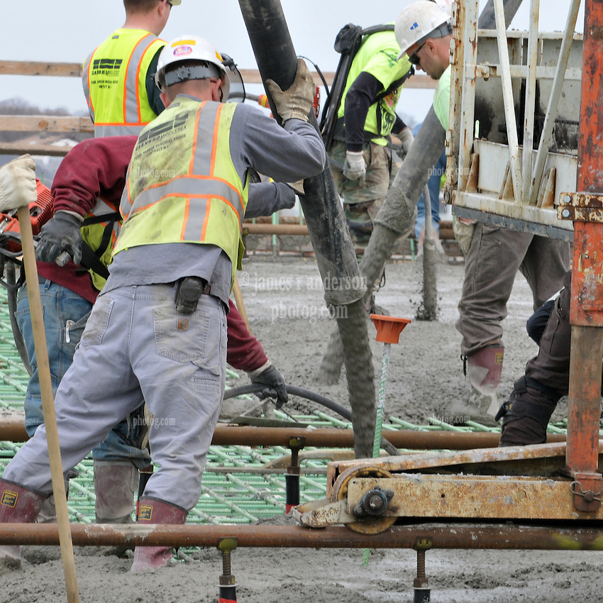Several Workers on a Deck Concrete Pour at the New Pearl Harbor Memorial Bridge, New Haven Harbor Crossing Corridor. CT DOT Contract B1 Project No. 92-618 Progress Photography. East end of the Northbound West Approaches. Eighth on site photo capture of every four month chronological documentation.