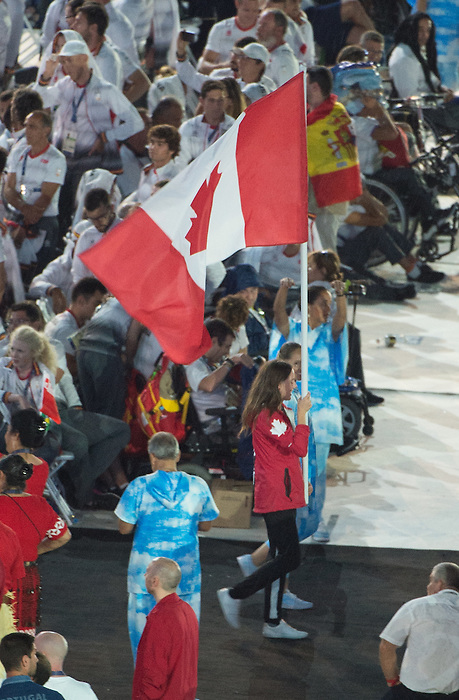 RIO DE JANEIRO - 18/9/2016: Aurelie Rivard carries the Canadian flag during Closing ceremonies in Maracana Stadium during the Rio 2016 Paralympic Games in Rio de Janeiro, Brazil. (Photo by Matthew Murnaghan/Canadian Paralympic Committee)