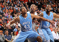 North Carolina forward James Michael McAdoo (43) and North Carolina guard Leslie McDonald (2) looks for the rebound with Virginia forward Akil Mitchell (25) during an NCAA basketball game Monday Jan. 20, 2014 in Charlottesville, VA. Virginia defeated North Carolina 76-61.