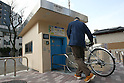Apr. 30, 2010 - Tokyo, Japan - A parking guard enters a bicycle to the elevator of an automated underground parking in Tokyo, Japan, on April 30, 2010. The Sugiyama Park Subway Bicycle Parking opened on April 20 and can store up to 250 bicycles. It costs 2,500 yen for a monthly ticket to use. Starting May 1, users who will park their bicycle in illegal spaces near Shin Nakano station will be ticketed.
