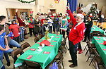 WATERBURY CT. 25 December 2018-122518SV01-Rev. Ken Frazier, right,  thanks volunteers and gets them ready to serve over 500 meals during the annual free Joy of Christmas Dinner at the First Congregational Church in Waterbury Tuesday.<br /> Steven Valenti Republican-American