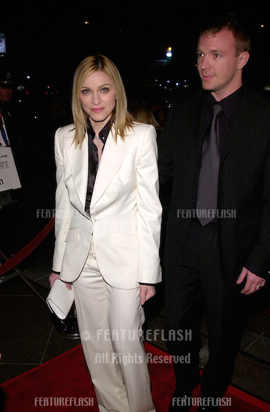 Pop star/actress MADONNA & director husband GUY RITCHIE at the Los Angeles premiere of his new movie Snatch..18JAN2001.  © Paul Smith/Featureflash