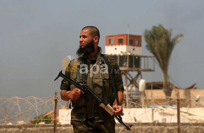Palestinian soldiers stand guard in Rafah, near the border with southern Gaza Strip, September 1, 2013. Egyptian security forces have stepped up a crackdown campaign since July on smuggling tunnels dug beneath the Gaza-Egypt border, Hamas officials said. Photo by Eyad Al Baba