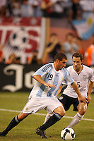 Argentina forward Lisandro Lopez (19) and United States defender Steve Cherundolo (6). Argentina The men's national teams of the United States and Argentina played to a 0-0 tie during an international friendly at Giants Stadium in East Rutherford, NJ, on June 8, 2008.