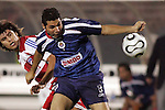 24 July 2007:  Jose Antonio Olvera (8) of CD Guadalajara appears to commit a handball foul.  FC Dallas tied Chivas de Guadalajara 1-1 at Pizza Hut Park in Frisco, Texas, in the opening match of SuperLiga 2007.