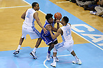 07 March 2015: Duke's Justise Winslow (center) is defended by North Carolina's J.P. Tokoto (13) and Brice Johnson (11). The University of North Carolina Tar Heels played the Duke University Blue Devils in an NCAA Division I Men's basketball game at the Dean E. Smith Center in Chapel Hill, North Carolina. Duke won the game 84-77.