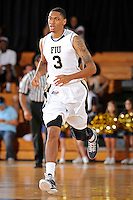 21 January 2012:  FIU guard-forward Dominique Ferguson (3) runs back down the court in the first half as the Florida Atlantic University Owls defeated the FIU Golden Panthers, 66-64, at the U.S. Century Bank Arena in Miami, Florida.