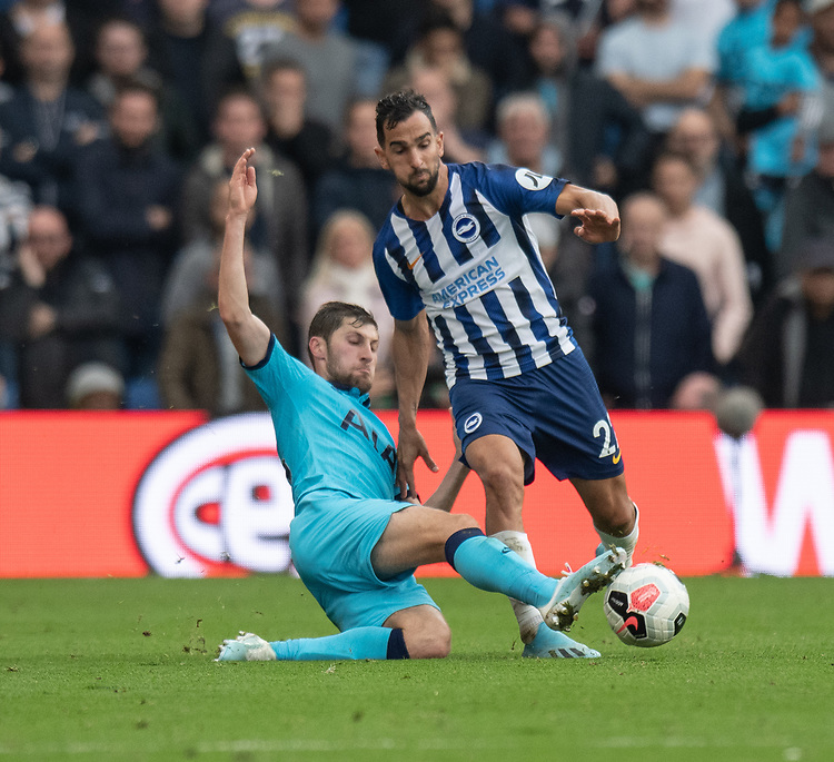 Brighton & Hove Albion's Martin Montoya (right) is tackled by Tottenham Hotspur's Ben Davies (left)<br /> <br /> Photographer David Horton/CameraSport<br /> <br /> The Premier League - Brighton and Hove Albion v Tottenham Hotspur - Saturday 5th October 2019 - The Amex Stadium - Brighton<br /> <br /> World Copyright © 2019 CameraSport. All rights reserved. 43 Linden Ave. Countesthorpe. Leicester. England. LE8 5PG - Tel: +44 (0) 116 277 4147 - admin@camerasport.com - www.camerasport.com