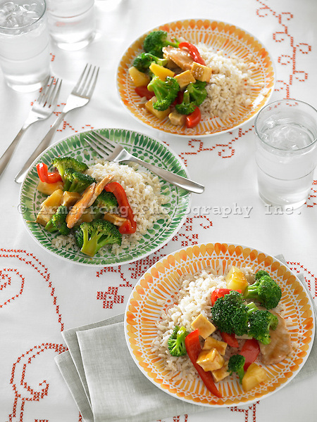 Stir fry with broccoli, tofu, red peppers, pork, and pineapple. Served in bowls with brown rice and ice water.