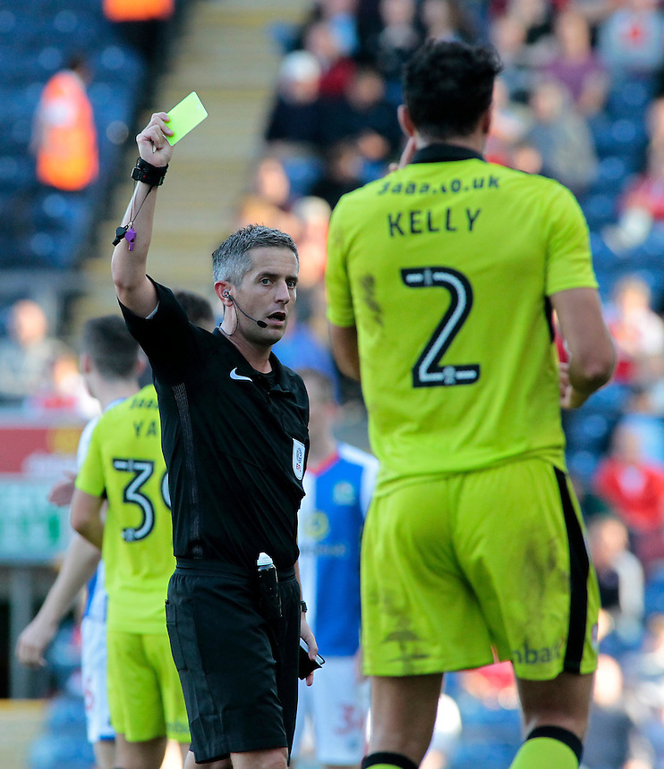 Referee Darren Bond shows a yellow card to Rotherham United's Stephen Kelly<br /> <br /> Photographer David Shipman/CameraSport<br /> <br /> The EFL Sky Bet Championship - Blackburn Rovers v Rotherham United - Saturday 17 September 2016 - Ewood Park - Blackburn<br /> <br /> World Copyright &copy; 2016 CameraSport. All rights reserved. 43 Linden Ave. Countesthorpe. Leicester. England. LE8 5PG - Tel: +44 (0) 116 277 4147 - admin@camerasport.com - www.camerasport.com