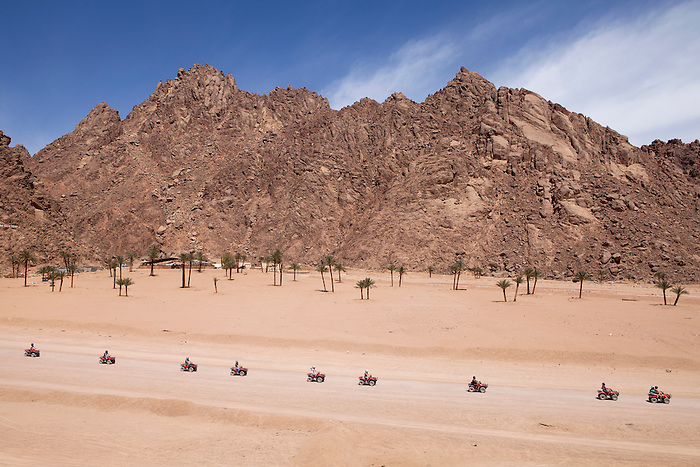 "Sharm el Sheikh, March 2015. A group on quad bikes on an expedition in the desert. Such trips are included in the ""all inclusive"" package, sold by tour operators. The trip usually includes a camel ride and a ""Bedouin dinner"" with a belly dancer show."