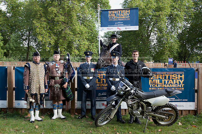 12/09/2012. LONDON, UK. Members of the British Army and Royal Air Force pose for a group shot in Hyde Park London today (12/09/12) after a taster of some of the acts taking part in the 2012 British Military Tournament. The theme of this year's tournament, involving all arms of the British military, is the life and times of Her Majesty the Queen and takes place at Earls Court in London on the 8th and 9th of December. Photo credit: Matt Cetti-Roberts