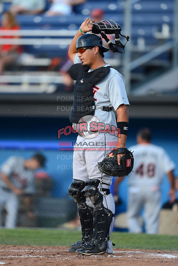 Tri-City ValleyCats catcher Ernesto Genoves (38) during a game against the Batavia Muckdogs on July 13, 2013 at Dwyer Stadium in Batavia, New York.  Tri-City defeated Batavia 5-4.  (Mike Janes/Four Seam Images)