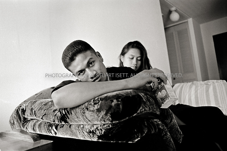 1/1994--Chicago, USA..Bobby and his 16 yr old girlfriend who is 6 months pregnant...All photographs ©2007 Stuart Isett.All rights reserved.This image may not be reproduced without expressed written permission from Stuart Isett.
