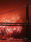 An annual fireworks display lit up the sky near one of the towers of the Bay Bridge in San Francisco at Piers 30/32 during an event put on by KFOG.