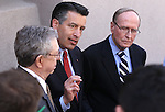 Former Nevada Govs. Robert List, left, and Richard Bryan, right, join Gov. Brian Sandoval in urging lawmakers to support Sandoval's plan to overhal the state's business license fee system, following their testimony at a hearing at the Legislative Building in Carson City, Nev., on Wednesday, March 18, 2015.  <br /> Photo by Cathleen Allison