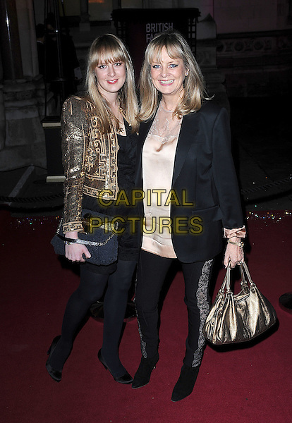 CARLY & TWIGGY LAWSON .attending The British Fashion Awards, Royal Courts of Justice, London, England, UK, 9th December 2009..arrivals full length gold daughter mother mum mom family sequined sequin jacket black lace trousers insert leggings bag dress clutch shoes peep toe cream beige silk satin top .CAP/BEL.©Tom Belcher/Capital Pictures.
