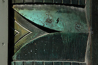 Tropical Rainforest Glasshouse (formerly Le Jardin d'Hiver or Winter Gardens), 1936, René Berger, Jardin des Plantes, Museum National d'Histoire Naturelle, Paris, France. Detail of decorative border around the arch of the Art Deco style main entrance, seen close up in the morning light.