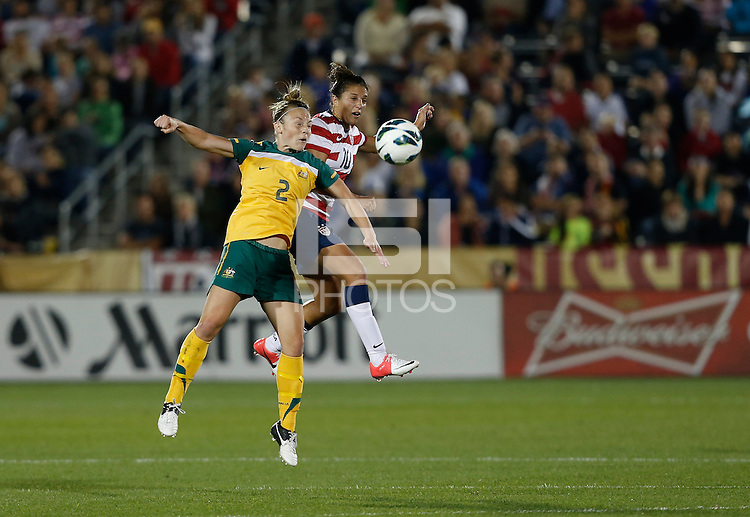 Commerce City, Colorado - Wednesday September 19, 2012; The  US WNT defeated the National team of Australia 2-1 during an International friendly game at Dick's Sporting Goods Park.  Carli Lloyd (10) of the USWNT goes up for a header against Teigen Allen (2) of Australia.