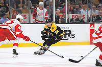 September 26, 2018: Boston Bruins left wing Jake DeBrusk (74) watches the puck during the NHL pre-season game between the Detroit Red Wings and the Boston Bruins held at TD Garden, in Boston, Mass. Detroit defeats Boston 3-2 in overtime. Eric Canha/CSM