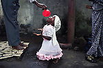 KINSHASA, DEMOCRATIC REPUBLIC OF CONGO APRIL 23: An unidentified girl drinks holy water at ?Ebale Mbonge? on April 23, 2006 in central Kinshasa, Congo, DRC. It?s a spiritual place where members come to get cured from bad and evil spirits. Many are suffering from different diseases and they hope to get cured while getting treatment. Kinshasa, a city of about eight million people is battling with bad infrastructure and no public transport. Congo, DRC is in ruins after forty years of mismanagement by the corrupt dictator and former president Mobuto Sese Seko. He fled the country in 1997 and a civil war started. The country is planning to hold general elections by July 2006, the first democratic elections in forty years.(Photo by Per-Anders Pettersson)
