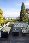 An expansive deck provides ample space for relaxing, entertaining or simply enjoying the lake view at this Pacific Northwest home. This image is available through an alternate architectural stock image agency, Collinstock located here: http://www.collinstock.com