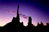 A silhoette of The Totem Poles rock pillars at sunrise in Monument Valley National Park and navaho Indian reservation,  Utah, USA