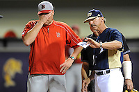 "2 March 2012:  FIU Head Coach Henry ""Turtle"" Thomas reviews the field boundaries with Brown Head Coach Marek Drabinski prior to the game as the FIU Golden Panthers defeated the Brown University Bears, 6-5, at University Park Stadium in Miami, Florida."
