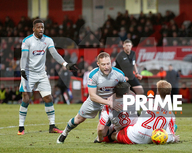 Grimsby's Ben Davies is felled by Stevenage's Steven Schumacher during the Sky Bet League 2 match between Stevenage and Grimsby Town at the Lamex Stadium, Stevenage, England on 28 January 2017. Photo by Carlton Myrie / PRiME Media Images.