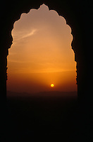 Sunset through an arched Indian doorway