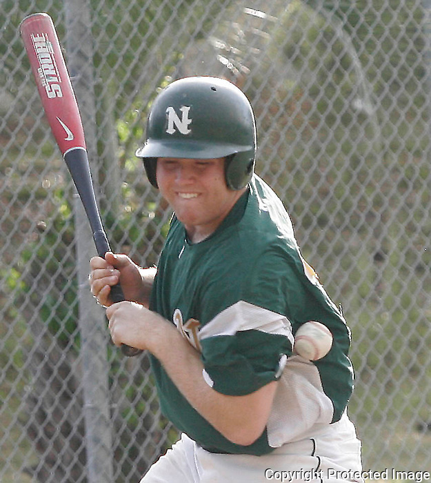 Gary Wilcox/Staff.... 04/18/07.... Nease Varsity Baseball player Ryan Chiodo (#15) gets hit by the ball during the game against Middleburg at Nease. Nease had a 9 to 1 win Tuesday night. (04/18/07)
