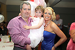 Denis and Lisa Lynch from Sharper Image Hair Salon with their daughter Keeva (who just turned 6) at their joint 40th in the Star and Crescent...Photo NEWSFILE/Jenny Matthews.(Photo credit should read Jenny Matthews/NEWSFILE)....This Picture has been sent you under the condtions enclosed by:.Newsfile Ltd..The Studio,.Millmount Abbey,.Drogheda,.Co Meath..Ireland..Tel: +353(0)41-9871240.Fax: +353(0)41-9871260.GSM: +353(0)86-2500958.email: pictures@newsfile.ie.www.newsfile.ie.FTP: 193.120.102.198.