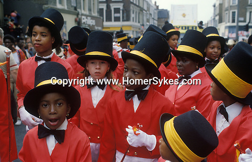 Notting Hill Carnival West London, Young black children one white girl. Black community 1970s England UK.<br />