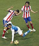Atletico de Madrid's Guilherme Siqueira (l) and Tiago Mendes (r) and UD Almeria's Michel Macedo during La Liga match.February 21,2015. (ALTERPHOTOS/Acero)