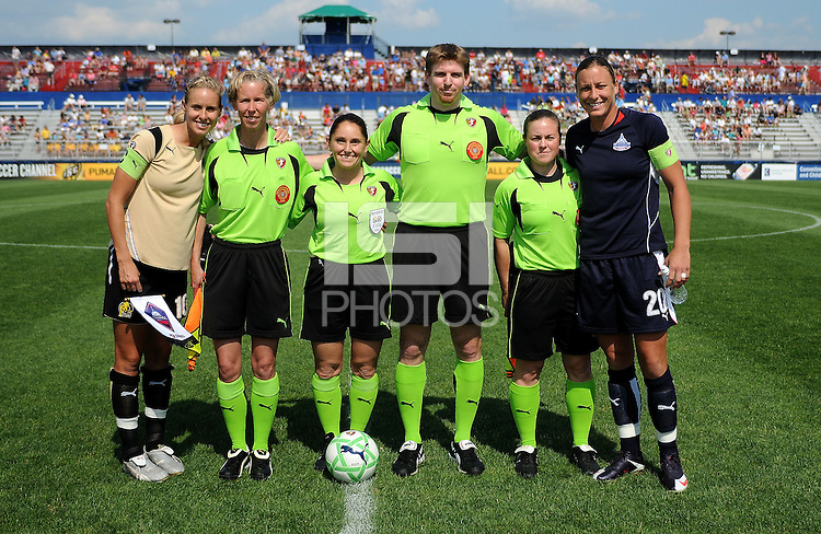 Washington Freedom captain Abby Wambach and FC Gold Pride captain Leslie Osborne at coin toss with referees.   Washington Freedom defeated FC. Gold Pride 3-1at the Maryland SoccerPlex, Sunday May 31, 2009.