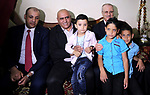 Palestinian Prime Minister Rami Hamdallah visits Nisreen Odeh who was lung transplant in India, in the West Bank city of Nablus on October 21, 2017. Photo by Prime Minister Office