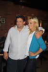 """General Hospital's Kelly Sullivan """"Kate"""" poses with Dino at Uncle Vinnie's Comedy Club on September 9, 2012 in Pt. Pleasant, New Jersey to see their fans for autographs, meet/greet and photos.  (Photo by Sue Coflin/Max Photos)"""