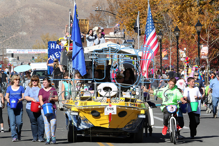 Participants toss candy to the crowd during the annual Nevada Day Parade in Carson City, Nev., on Saturday, October 28, 2017. <br />