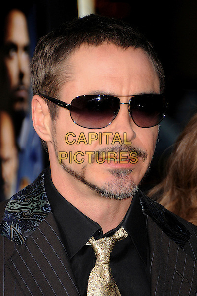 "ROBERT DOWNEY JR. .""Iron Man"" Los Angeles Premiere at Grauman's Chinese Theatre, Hollywood, California, USA,.30 April 2008..portrait headshot beard facial hair gold tie black shirt sunglasses.CAP/ADM/BP.©Byron Purvis/Admedia/Capital PIctures"