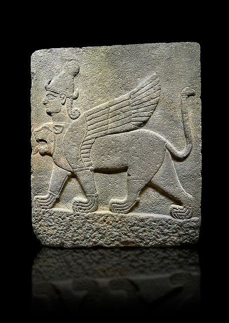 Photo of Hittite relief sculpted orthostat stone panel of Herald's Wall Basalt, Karkamıs, (Kargamıs), Carchemish (Karkemish), 900-700 B.C. Chimera. Anatolian Civilisations Museum, Ankara, Turkey.<br /> <br /> Three-headed sphinxes. Winged lion, with a bird of prey's head on the end of its tail, also has a human head with hair in plaits and a conical headdress. The details in his feet are very distinct.  <br /> <br /> Against a black background.