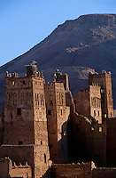 Storks in their nests perching on top of a kasbah, Ait Benhaddou, Morocco.