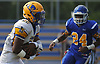 Chris Collier #22, Lawrence running back, rushes for a gain during the first quarter of a Nassau County Conference III varsity football game against host Roosevelt High School on Saturday, Sept. 16, 2017.